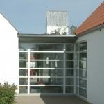 Glas mellembygning